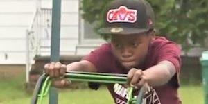 Boy mowing